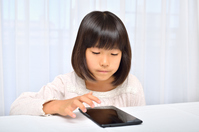 Girl playing in the tablet Stock photo [4963754] have