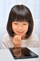 Girl playing in the tablet Stock photo [4963757] have