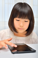Girl playing in the tablet Stock photo [4963758] have