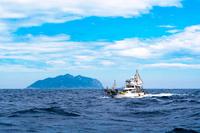 Fishing boat with Okinoshima Stock photo [5058675] Landscape