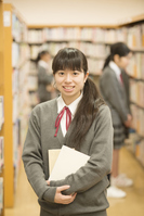 Female students smiling with a book in the library Stock photo [5066895] Book