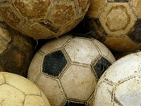 The worn-out soccer ball Stock photo [601280] Football