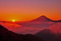 Fuji drilling in Clouds stock photo