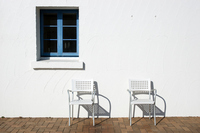 White walls and blue window frames, pipe chair Stock photo [2221405] White