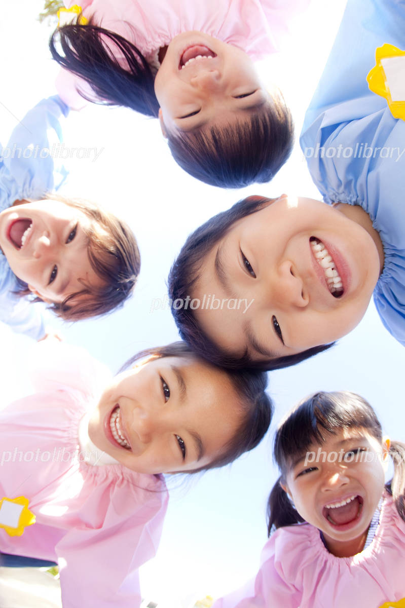 Kindergarten five people laugh in a circle Photo