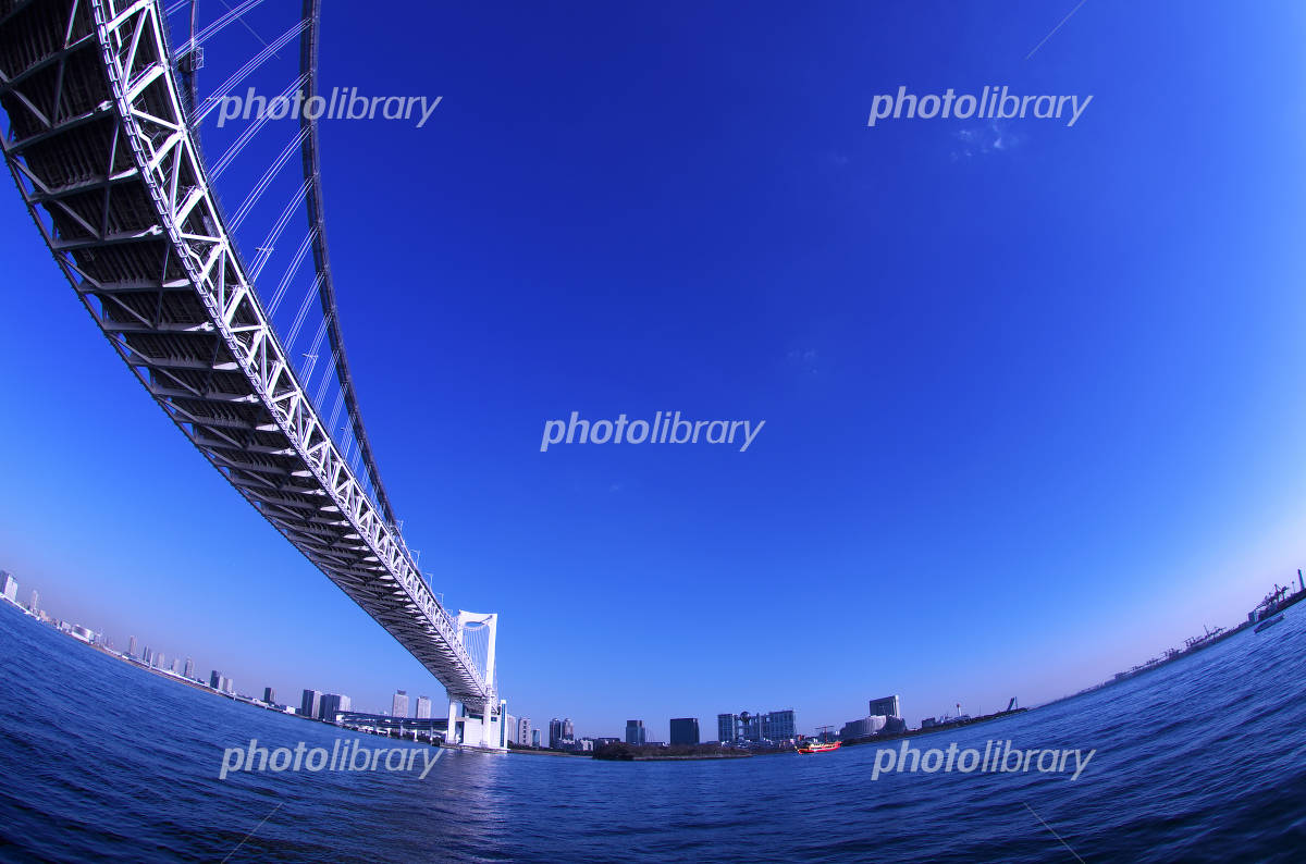Blue sky of Rainbow Bridge overlooking than Shibaura Photo