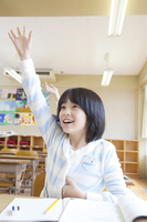 The Hand Raised elementary school girls in class Stock photo [2348873] Happy