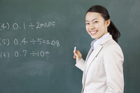 Female teacher to write a problem on the blackboard People