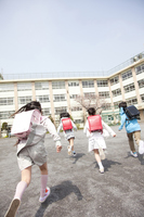 Rear View of four elementary school children to school Stock photo [2349006] Four