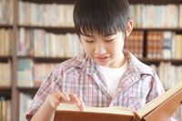 Elementary school students read a book in the library boys Stock photo [2349038] Happy