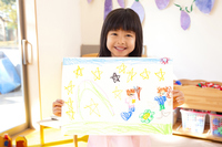 Kindergarten girls smile with a picture Stock photo [2349981] Happy