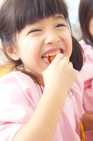 Kindergarten girls eat a cherry tomato Stock photo [2350080] Happy