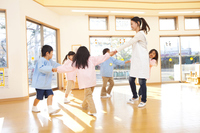 Kindergarten teachers and kindergarten children dancing in a circle Stock photo [2350101] Asian