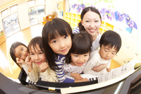 Nursery school children and nursery teacher to smile in front of the piano Stock photo [2350148] Happy