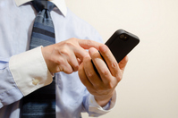 Businessman and smartphone Stock photo [2599608] Businessman