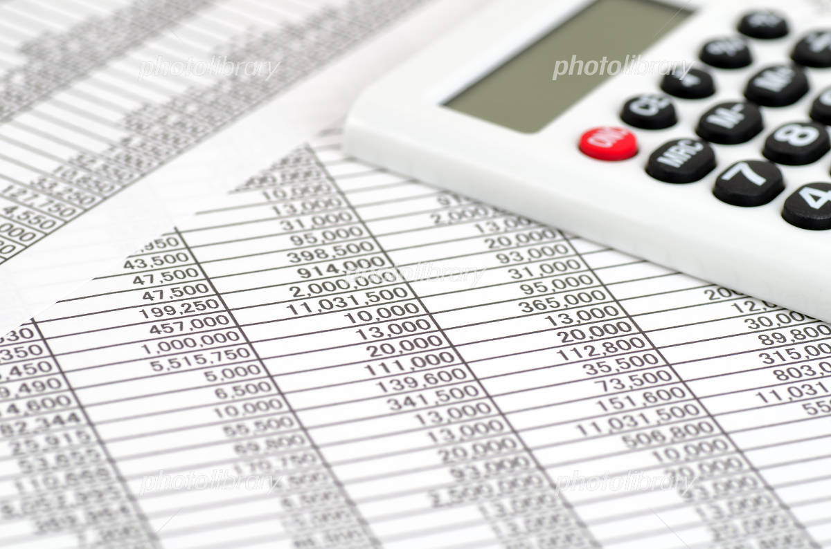 Accounting documents and calculator Photo