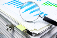 Piled up documents and materials and magnifying glass Stock photo [2947802] Material