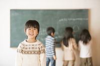 Boy in elementary school that smile in front of the blackboard Stock photo [3511565] Primary