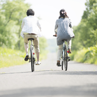 Rear View of a couple riding a bicycle Stock photo [3512097] Cycling