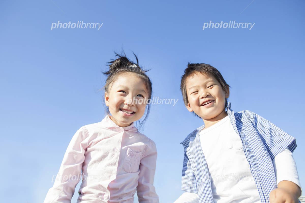 Children of blue sky and smile Photo