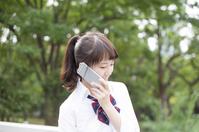 Schoolgirl image after school park uniforms to talk with smartphone Stock photo [4974222] smartphone