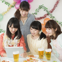 Four women watching Tablet PC Stock photo [5077178] party