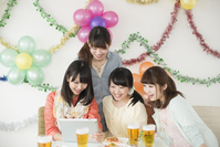 Four women watching Tablet PC Stock photo [5077182] party