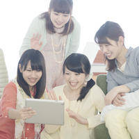 Four women watching Tablet PC Stock photo [5077242] Tablet