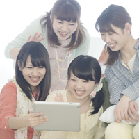 Four women watching Tablet PC Stock photo [5077245] Tablet