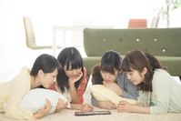Four women watching Tablet PC Stock photo [5077289] Tablet