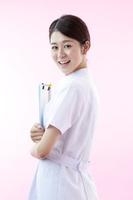 写真 A nurse with a medical record Pink back(5262094)
