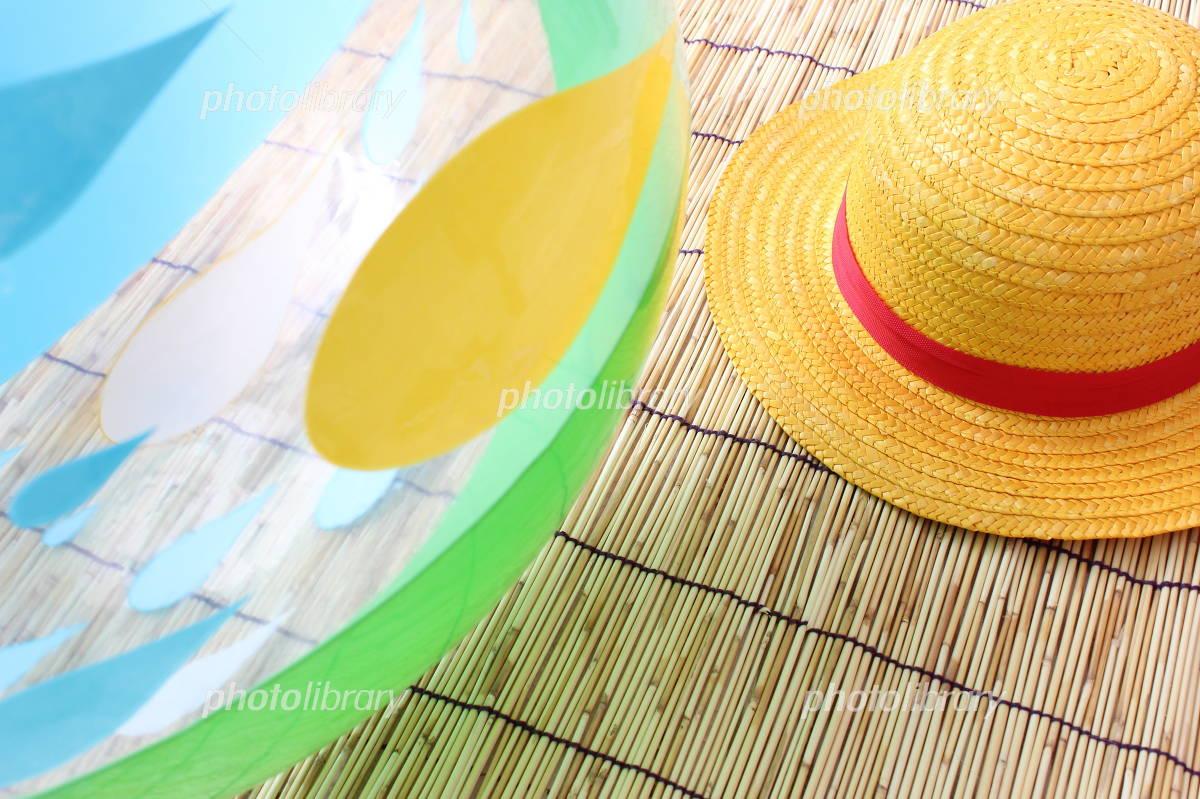 Beach ball and straw hat Photo