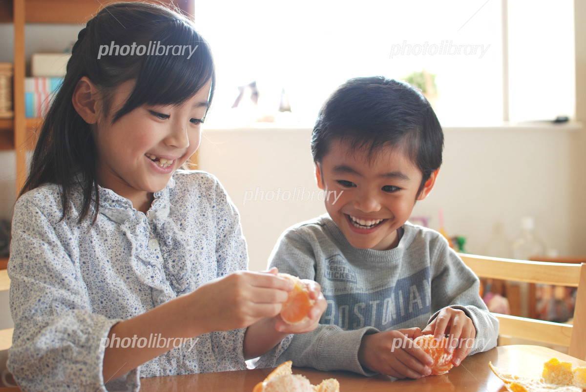 Children eat a tangerine Photo