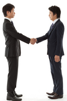 Two businessmen shaking hands Stock photo [2241333] Businessman