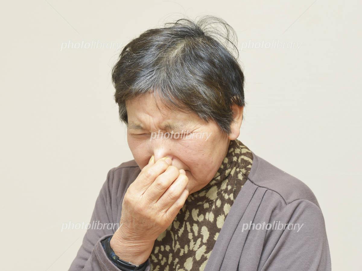 Women pinch the nose Photo