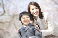 Portrait of elementary school boys and mother standing under the cherry tree Stock photo [2362543] Mom