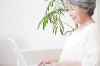Senior women smile to see a laptop Stock photo [2372877] PC