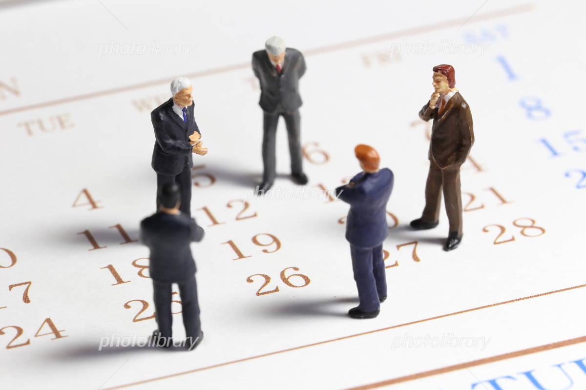 Calendar and businessman Photo