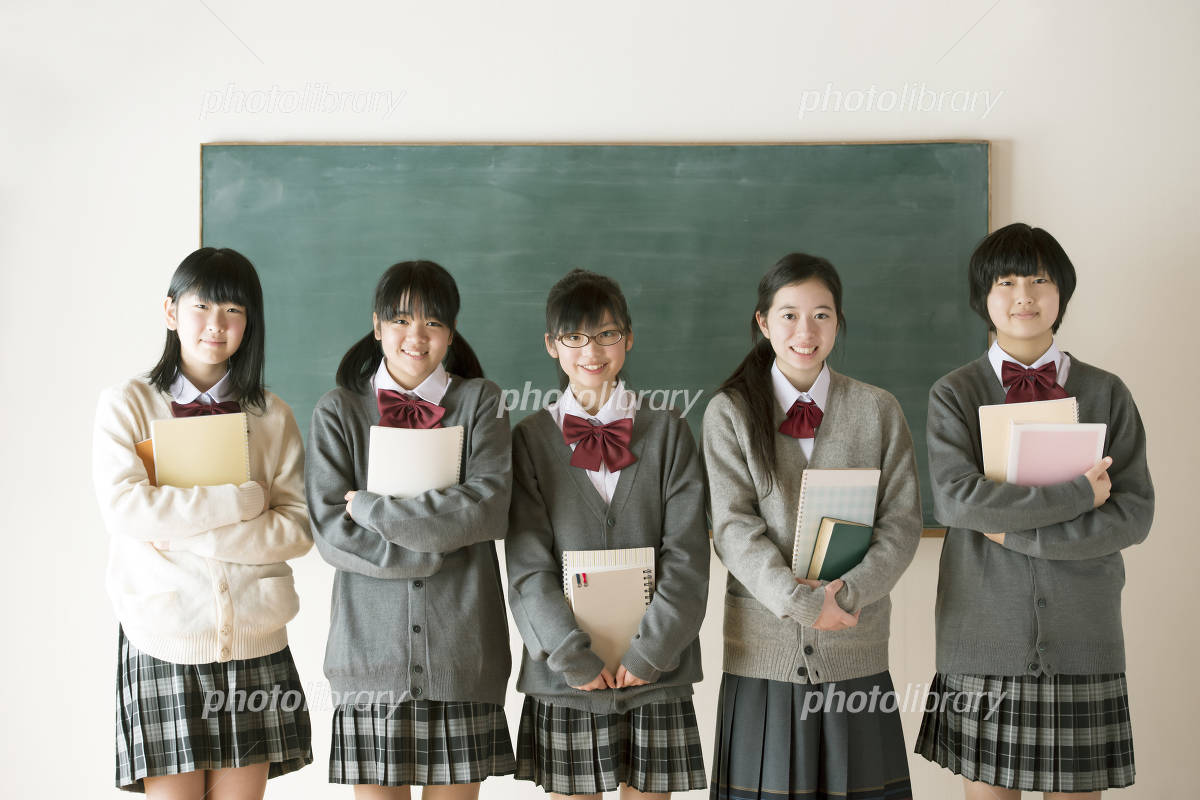 Junior high school students to smile in front of the blackboard Photo