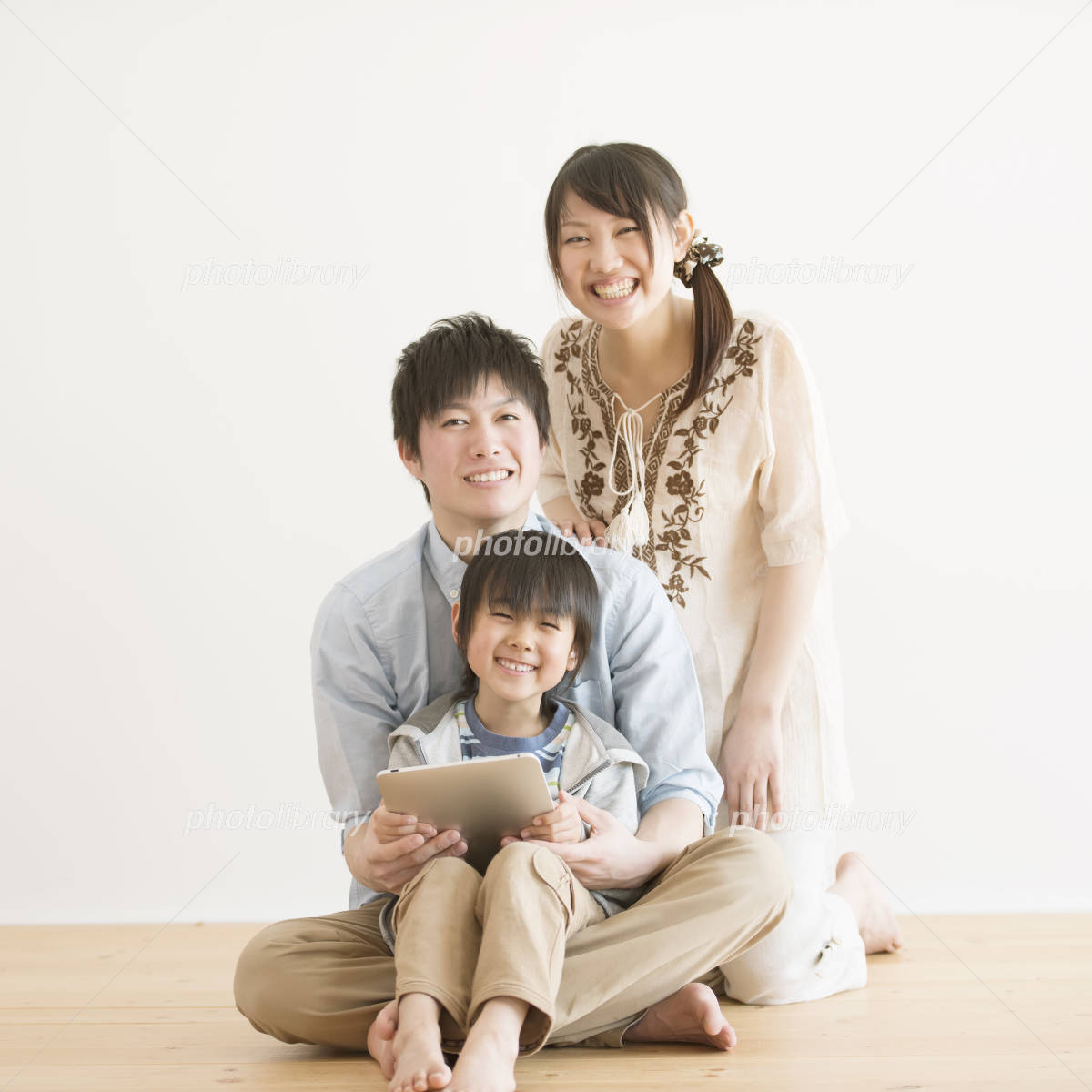 Family to smile has a tablet PC Photo