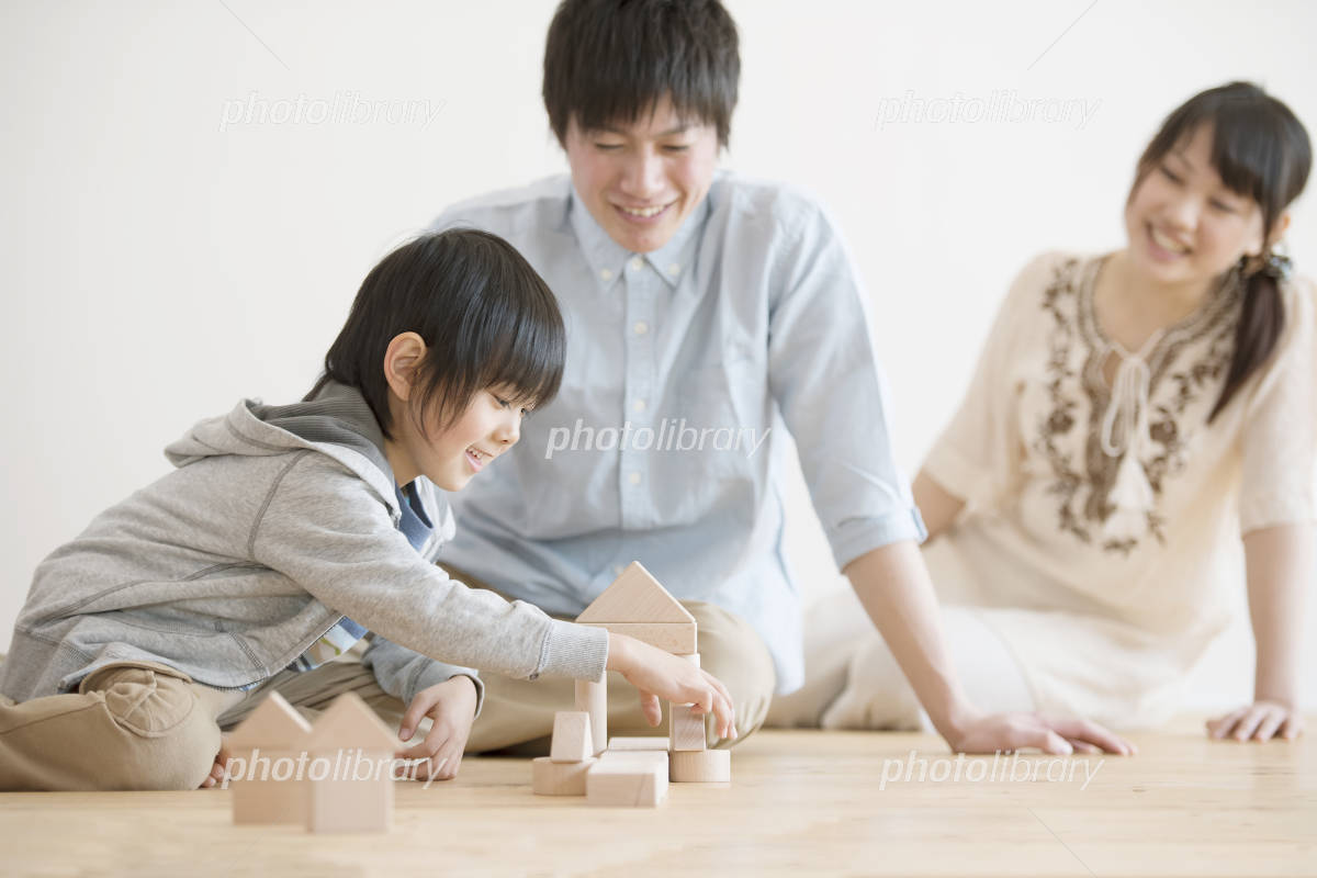 Family playing in the building block Photo