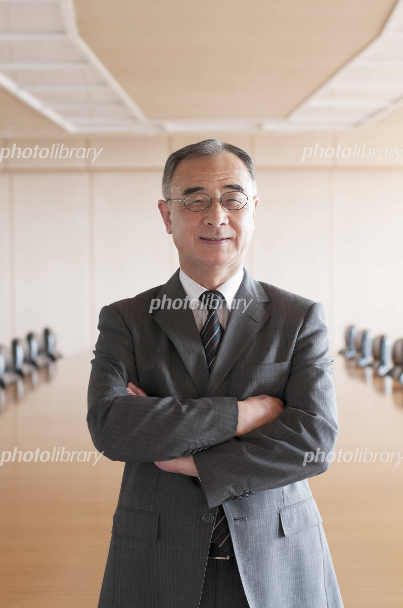 Businessman smiling in a conference room Photo