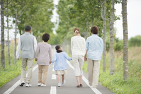 Rear View of Holding Hands 3 generation family by a single road Stock photo [3039723] 3