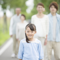 Family to watch a girl smile in one straight road Stock photo [3039735] 3