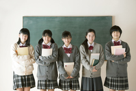 Junior high school students to smile in front of the blackboard Stock photo [3040536] Middle