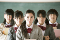 Junior high school students to a serious look in front of the blackboard Stock photo [3040564] Middle