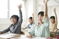 Hand Raised elementary school students in the classroom Stock photo [3041943] Primary