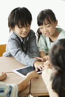 Elementary school students to operate the tablet PC Stock photo [3044003] Primary