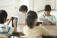 Elementary school students to operate the tablet PC Stock photo [3044009] Primary