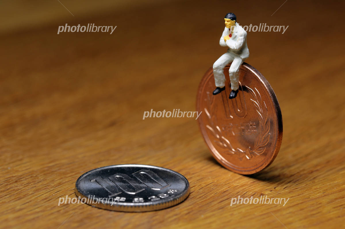 Coins and businessman Photo